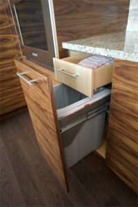 This fun custom cabinet feature hides both the garbage and a drawer to hold extra trash bags, dish towels, or whatever.