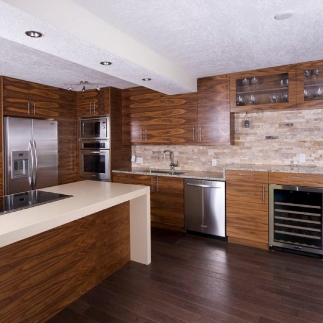 After photo of the horizontal walnut cabinets that run throughout this truly contemporary kitchen. This kitchen looks so good now, we think it should be on the cover of a magazine!