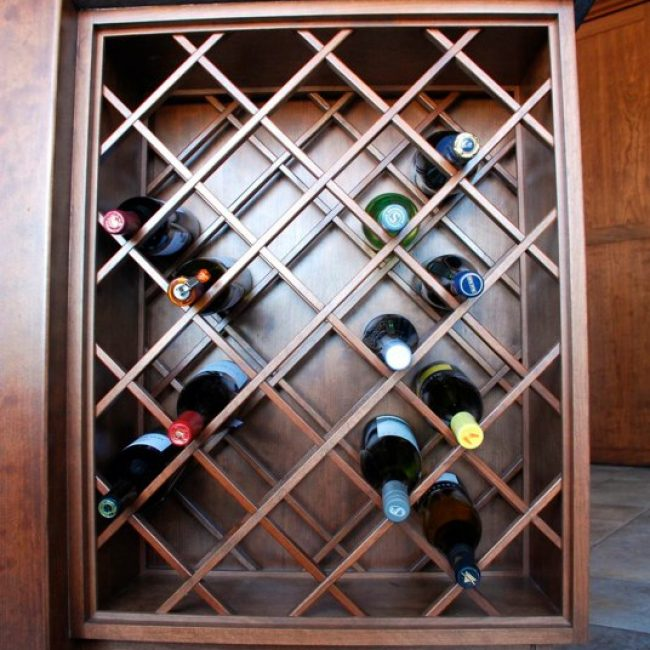 This custom made latticed wine rack is able to hold 32 bottles and fits perfectly under the counter.