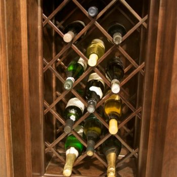 A close-up view of an under-counter built in lattice wine storage rack that's both functional and fun to look at.