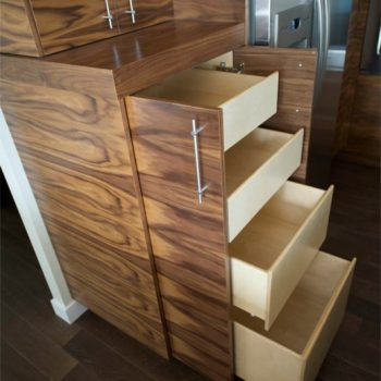 A close-up sideview of how our custom pull-out pantry drawers look and work, shown here in our horizontal walnut kitchen cabinets project.