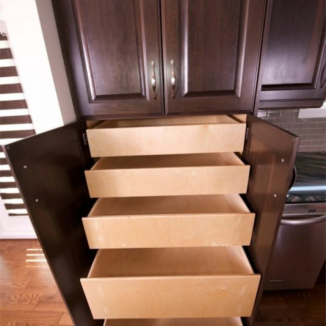 We replaced the traditional cupboard shelves with these pull-out pantry drawers, making it way easier to quickly find and access whatever it is you're looking for.