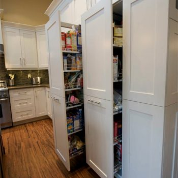 We made these custom pull-out pantry cabinets to maximize storage efficiency. On the outside they look like normal kitchen cupboard doors, but pull them open and you find a novel new way of storing your food.