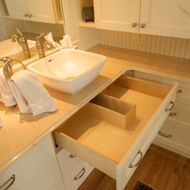 We made these drawers for a client who really needed some better bathroom storage solutions. We also customized this specialty drawer to fit around the sink's drainage pipe.