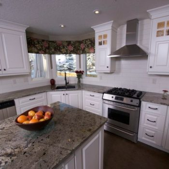 After shot of some truly gorgeous white laquer kitchen cabinets, courtesy of Evolve Kitchens.
