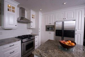 Beautiful white laquer kitchen cabinets, custom made by Evolve Kitchens