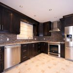 Shaker style walnut kitchen cabinets and and doors, made and installed by Evolve Kitchen