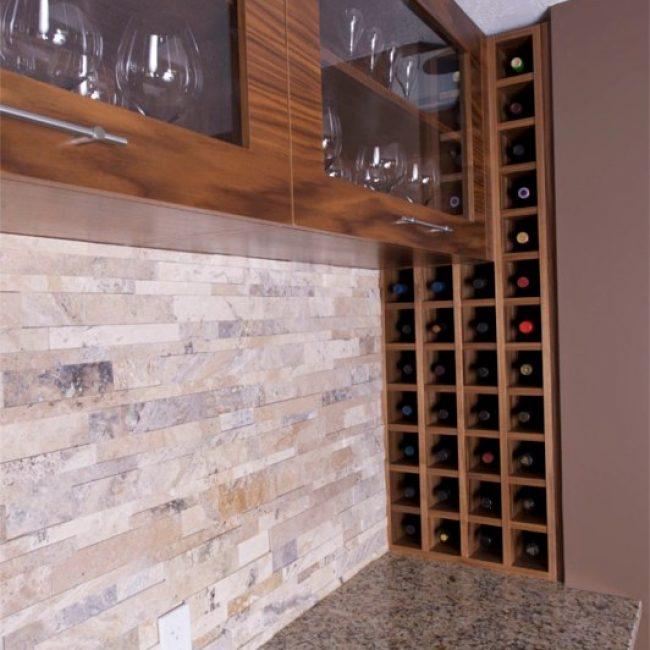 Close-up after photo of the built-in wine rack we made and tucked into the side wall, next to the custom horizontal walnut kitchen cabinets.