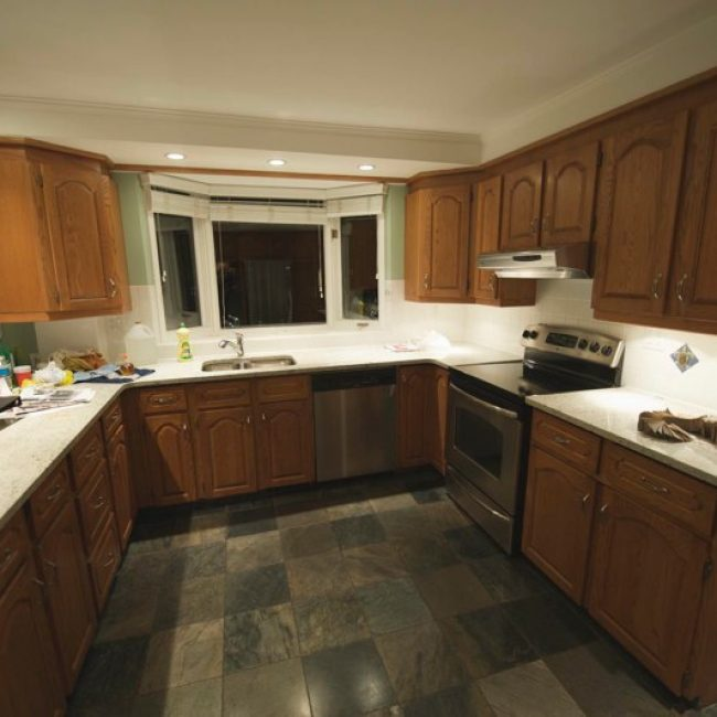 Before photo of another dated kitchen in desperate need of some new high-quality, custom-made cabinets by Evolve Kitchens!