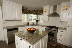 Evolve Kitchens makes durable and beautiful custom kitchen cabinets, like these white cabinets and kitchen island storage spaces.